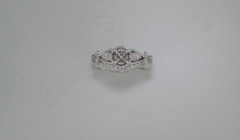 Semi mount bridal set in 14kt white gold with 35 diamonds =.21ct.  Style 723-0041 $2400.00
