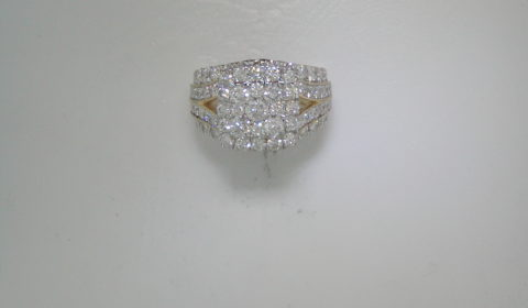 Halo style 4 row diamond ring set in 14kt yellow gold with 75 diamonds =3.76ct.  Style 910-0063.  $7000.00