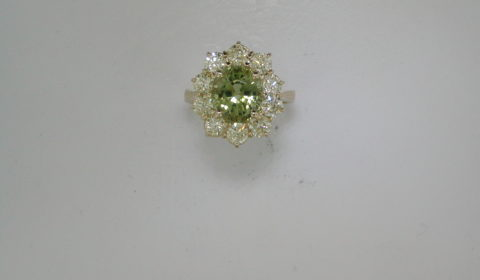 3.42ct  Green Tourmaline ring in 14kt yellow gold with 10 diamonds =1.95ct.  Style 910-0071.  $4600.00
