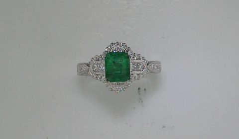1.06ct Emerald ring in 18kt white gold with 68 diamonds =.80ct.  Style 910-0072. $3500.00