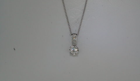 Illusion diamond pendant =.88ct set in 14kt white gold with diamond bail with 3 diamonds =.12ct.  Style 412-0115. $9000.00