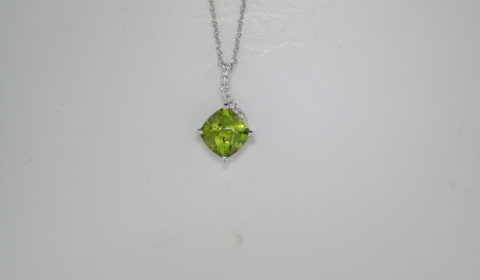 1.38ct Peridot checkerboard cut pendant in 14kt white gold with 9 diamonds =.05ct on an 18in chain.  Style 950-0175.  $575.00