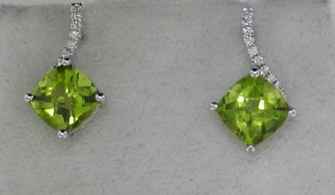 2.64ct peridot checkerboard cut earrings set in 14kt white gold with 18 diamonds =.09ct.  Style 950-0176.  $750.00