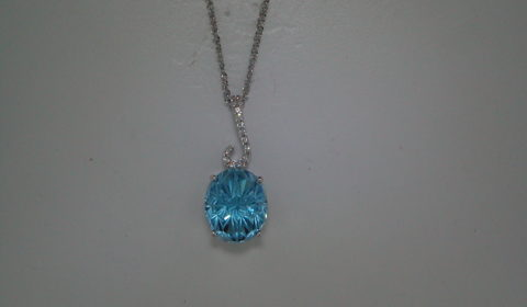 Daisy oval cut blue topaz pendant =7.06ct set in 14kt white gold with 13 diamonds =.08ct on an 18in chain.  Style Y370596PWTP.  $1175.00