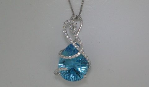 9.03ct Blue topaz pendant set in 14kt white gold with 52 diamonds =.37ct on an 18in spiga chain.  Style 950-0179.  $2350.00