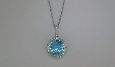 3.37ct Blue topaz pendant in 14kt white gold with 27 diamonds =.24ct on an 18in chain.  Style 950-0180.  $1295.00