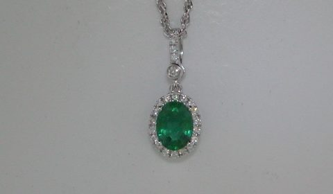 1.11ct emerald pendant in 14kt white gold with 23 diamonds =.22ct on an 18in chain.  Style 950-0182. $4975.00