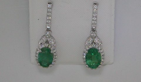 1.74ct emerald earrings in 14kt white gold with 62 diamonds =.30ct.  Style 950-0184.  $2300.00