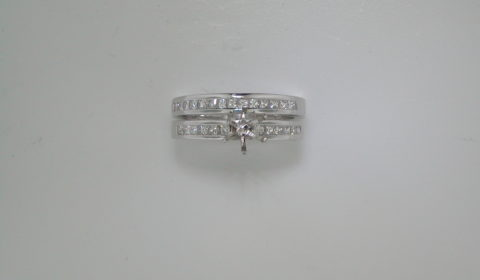 Semi mount bridal set in 18kt white gold with 26 princess cut diamonds =.78ct.  Style 750-0668.  $3650.00