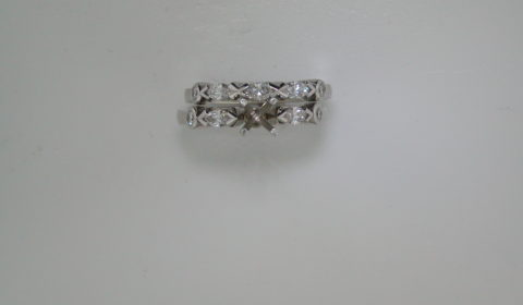 Semi mount bridal set in 14kt white gold with 5 marquise cut diamonds =.75ct and 4 round diamonds =.16ct.  Style 750-0672.  $3800.00