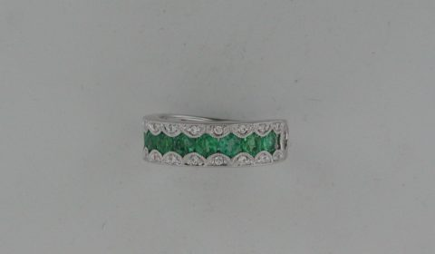 Emerald ladies band in 18kt white gold with 20 diamonds =.15ct and 9 emeralds =1.26ct Style RB153368W8940 $3900.00