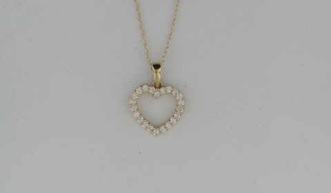 Heart shaped pendant in 14kt yellow gold with 22 diamonds =.38ct on an 18in chain Style P44479D2921 $1200.00
