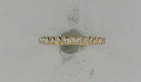 Wedding band in 18kt yellow gold with 15 diamonds =.17ct Style R134645DD940 $1020.00