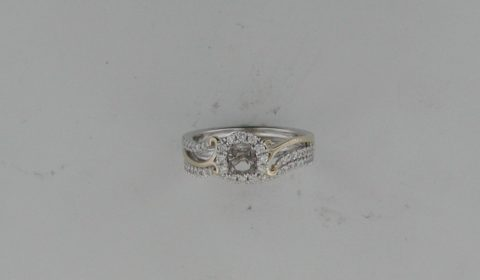 Semi bridal set in 14kt two tone gold with 49 diamonds =.39ct.  Style OC20A79/.40 and .40W $2400.00