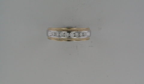 Gents 14kt yellow and white gold wedding ring with 8 diamonds =.25ct.  Style G13A20 $1950.00