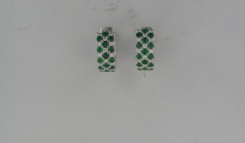 Emerald huggie style earrings in 14kt white gold with 30 diamonds =.44ct and 30 emeralds =.1.41ct.  Style OE19A35EM.  $3800.00