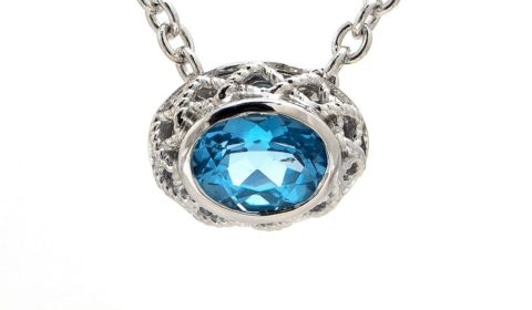 Blue topaz pendant in sterling silver and 18kt yellow gold with 32 diamonds =.17ct Style ACN152/17-BT.  $600.00