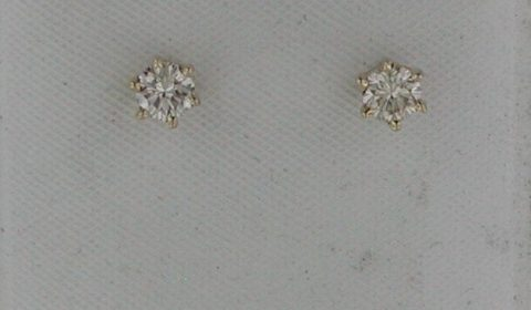 Diamond stud earrings in 14kt yellow gold in a cognac color =.44ct.  Style 750-0694 $1000.00