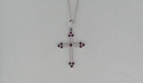 Ruby cross pendant in 14kt white gold =.30ct  with 17 diamonds =.12ct on an 18in chain.  Style P6707WR6001.  $850.00