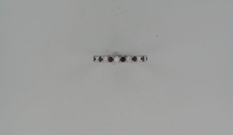 Ladies ruby band in 18kt white gold =.30ct with 6 diamonds =.20ct.  Style R32579W9GM.  $1275.00