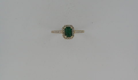 Emerald ladies ring in 14kt yellow gold =.62ct with 36 diamonds =.20ct.  Style R5298DE6001 $1900.00