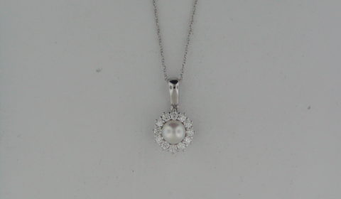 6mm freshwater pearl pendant in 14kt white gold with 12 diamonds =.33ct on an 18in chain.  Style 85951.  $1375.00