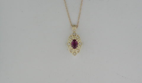 Ruby pendant in 14kt yellow gold =.46ct with 9 diamonds =.07ct Style 87357 $1650.00