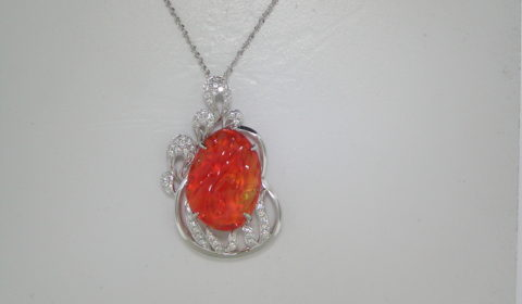 Fire opal pendant =5.47ct set in 14kt white gold with 51 diamonds =.20ct.  Style 231621.  $2650.00