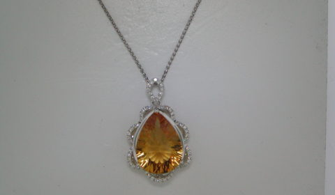 Citrine pendant =6.60ct set in 14kt white gold with 61 diamonds =.31ct.  Style 225702.  $1900.00