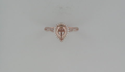 Semi mount halo ladies engagement ring in 14kt rose gold with 84 diamonds =.32ct.  Style 123267:1064:P.  $2350.00