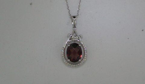 Garnet pendant =1.77ct in 14kt white gold with 23 diamonds =.07ct.  Style Y450040PWGA.  $725.00